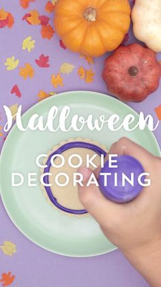 Watch this fall dessert recipe video tutorial to learn how to decorate cookies for Halloween.