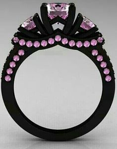 Pink diamonds and black gold ring