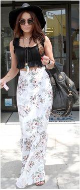 Vanessa Hudgens wearing a black crop top and printed maxi skirt