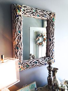 Driftwood Mirror Makeover.... Painted White and Added Shells from the Beach. For more Coastal and Beach Mirror Ideas, go to CC: http://www.completely-coastal.com/search/label/DIY%20Mirrors