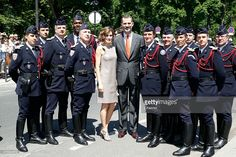 Spanish King Felipe VI and Queen Letizia pose with motorcyclists of...