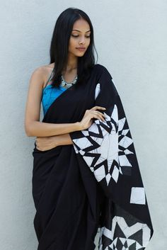 This monochrome handcrafted cotton batik saree is inspired by the beautiful jewelry worn by Maasai women in Africa. Comes with a striking jewel blue jacket piece and can be worn for any occasion with minimal jewelry.