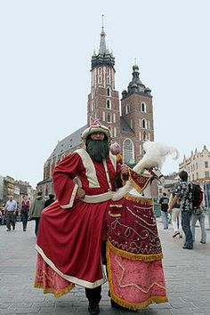 """The Lajkonik is man dressed up as a warrior from the east. He rides a prancing white hobbyhorse through the city streets of Kraków.   Tartars/Mongols invaded and decimated Poland three times in the 13th century.  The threat they posed dominated central and east European political and religious life for 200 years or so... In regional folklore the Tatar assumed the position of bogeyman, as the Kraków Corpus Christi """"Lajkonik"""" procession colorfully reminds one"""""""