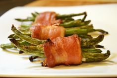 Maple bacon wrapped green beans is our winner for We recommend using ghee/lard instead of the recommended butter. Bacon Wrapped Green Beans, Green Beans With Bacon, Veggie Recipes, Healthy Recipes, Healthy Foods, Free Recipes, Delicious Recipes, Green Bean Bundles, Grilling Sides