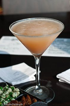 BELLINI MARTINI.  Ingredients: 8 ice cubes,  3 oz Smirnoff® vodka,  1 1/2 oz peach nectar,  1 1/2 oz peach schnapps,  1 twist lemon peel.  Directions:   Add ice cubes to shaker. Add vodka. Add peach schnapps. Add peach nectar. Shake. Strain into glass. Add lemon twist.  Wait... the one I like also adds champagne to the mix.  Try it.