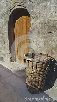 Basket in front of wooden door.