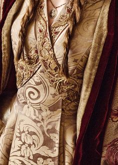 "Wedding gown costume worn by Sophie Turner playing Sansa Stark in ""Game of Thrones."" Season 3, episode 8, ""Second Sons."" Screen capture. You can barely see the button at the waist where the right panel attaches to the left."