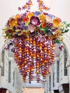 Celebrated British paper artist Zoe Bradley creates 2 huge paper floral chandeliers for Burlington Arcade London to launch new retail concept