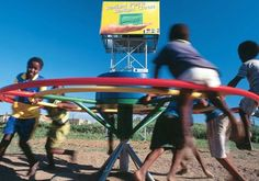 PlayPump — a child's merry-go-around that pumps potable water from a deep borehole to a 2,500-liter storage tank that is seven meters above the ground.