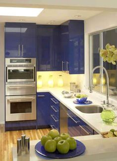 For a European contemporary kitchen, go with high-gloss lacquer cabinets in a bright primary color, like this brilliant blue