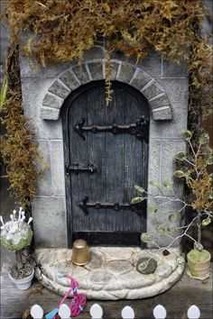 fairy gardens | ... fairy door in her South Toledo garden. VIEW : Fairy gardens photo