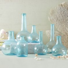 Aquamarine Blues Set of 7 Decorative Vintage Bottles. These hand blown glass bottles remind me of sea glass.