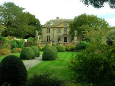 Tintinhull Garden, located in Tintinhull, Yeovil, Somerset, England is a small 20th century Arts and Crafts garden surrounding a 17th century house. The property is in the ownership of the National Trust. I love england