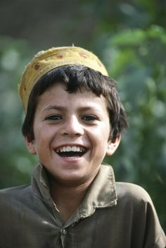 In 1988 in Pakistan, a boy laughs in a camp for Afghan refugees in the north-western city of Peshawar. Good Smile, Beautiful Smile, Beautiful Children, Make You Smile, Beautiful People, Kids Around The World, We Are The World, People Around The World, Child Smile