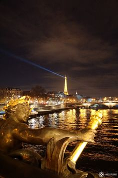 Pont Alexandre III at night with the Eifel Tower in the background