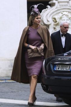 Máxima in a purple dress by Bottega Veneta. Click on the image to see more looks.
