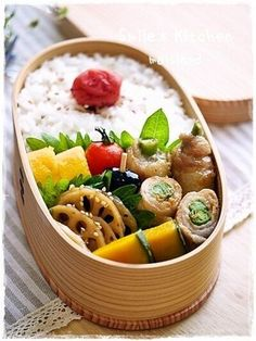 Japanese Bento Box featuring French Beans and Cheese Pork Roll, Braised Lotus Root Kinpira, Simmered Kabocha Squash, Dashimaki egg roll