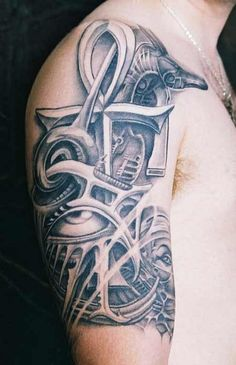 grey ink ankh and anubis biomechanical tattoo on half sleeve - http://tattooswall.com/grey-ink-ankh-and-anubis-biomechanical-tattoo-on-half-sleeve.html #and, ankh, anubis, biomech tattoos, biomechanical, grey, half, ink, on, sleeve, tattoo