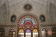 """Āmeri House Saraye Ameriha is one of the most valuable traditional houses among Kashan's famous historical houses. It is located in the """"Soltan mir Ahmad"""" area on Alavi Street near Kamal-al-Molk Square. The ancient beginnings of this building site possibly go back before the era of Genghis Khan. Historical documents also show a connection to the Zand dynasty in the 1700's, and rebuilding during the Qajar era (1794 - 1925) by the Qajar majesty, Ibrahim-Khalil Khan."""