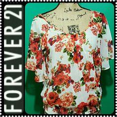 Forever 21 Ladies Top Forever 21 Signature Brand in Loose Fit Style,  Short Sleeves with Lovely Trendy Forever 21 Pattern,  Garter on Waistline, Used in Mint Condition! Forever 21 Tops