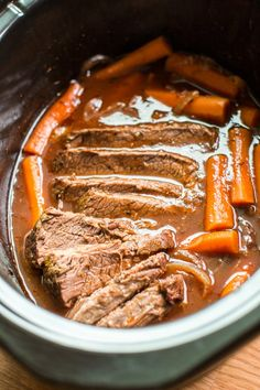 This Slow Cooker Red Wine Beef Brisket is slow-cooked to perfection. The brisket turns out perfectly tender and has tasty carrots and a red wine tomato gravy. Slow Cooker Brisket, Crock Pot Slow Cooker, Slow Cooker Recipes, Meat Recipes, Cooking Recipes, Crockpot Meals, Beef Brisket Recipes Crockpot, Beef Brisket Crock Pot, Game Recipes
