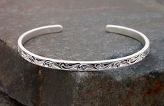 Handmade solid sterling bracelet is meticulously hand engraved. This style of push hand engraving is rapidly becoming a lost art and is truly unique. Handmade by Michael Dobrow of Sierra Silver Designs. $50