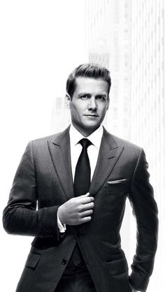 """Gabriel Macht as Harvey Specter in grayscale promo still for the TV show SUITS. Peak lapel ropestripe suit, french cuff spread collar shirt, silk tie and pocket square all by TOM FORD. This is the same TF """"O'Connor"""" suit Daniel Craig wore in SKYFALL, but here Harvey's has of course the wider peak lapels, as well as waist pocket."""