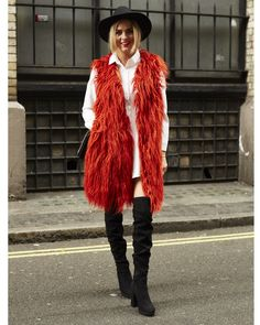 Kristy Green wears a Missguided fur coat, Public Desire boots and an In The Style dress