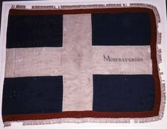 This flag is believed to have been issued to Waters' Battery of Mobile, Alabama early in 1863. Only two other flags of this design (white St. George's Cross on a blue field) are known to have survived. One, the flag of the 22nd Alabama Infantry (86.2759.1) is in the Archives' collection. The other flag, believed to be that of the 24th Alabama Infantry, is in the collection of the Chicago Historical Society.
