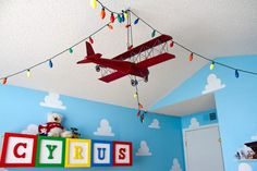 Hanging Airplane with Christmas Lights in this Toy Story Theme Room - #projectnursery
