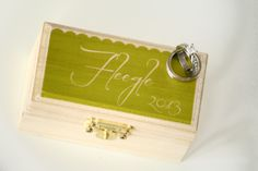 Customize with your wedding colors and name.  Custom Ring Bearer Box from Little Wee Shop on Etsy:  https://www.etsy.com/shop/LittleWeeShop?ref=si_shop