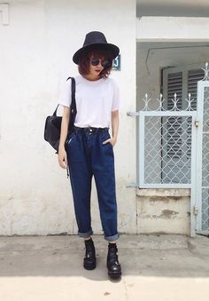 white top, jeans ans black bag