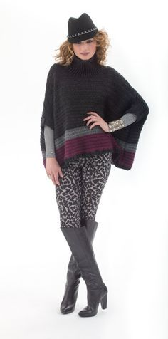 Black and grey printed pants, grey shirt, black/grey/purple poncho, black hat, gold bracelets, gold rings, black boots