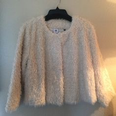 Faux fur coat Super on trend. Very warm and comfy. Cream. Cropped. Long sleeve. Worn twice. Excellent condition. No rips or stains. CAbi Jackets & Coats