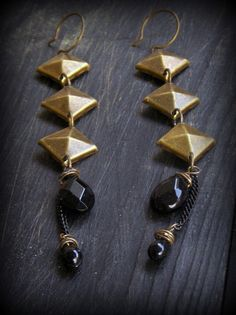 Of Onyx eyes and Temples. Found metal object and black onyx long earrings