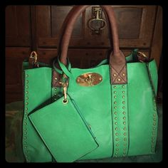 ♦️NEW LISTING Leather handbag-detachable strap NWT Gorgeous green leather handbag with detachable shoulder strap. Matching coin purse includes. Gold studded detail along edges and in front. I absolutely love these bags and plan to keep whichever doesn't sell first. Don't let this beauty get away. Brand new tags. EMPIRE New York Bags