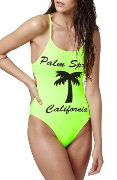 An open back with thin, crisscrossing straps adds some sass to this neon one-piece swimsuit from Topshop.