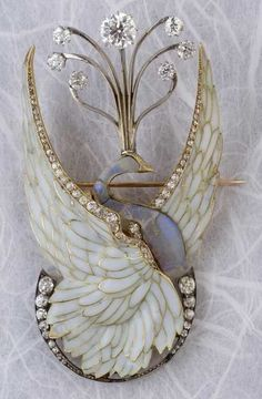 Philippe Wolfers A rare Art Nouveau gold, silver, plique-à-jour enamel, diamond and opal brooch