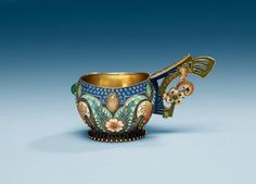 A Russian early 20th century silver-gilt and enamel kovsh, makers mark of Fedor Rückert, Moscow 1899-1908.