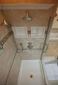 I like this - great shower space, with shower head, detachable spray, cool shelves! Very nice