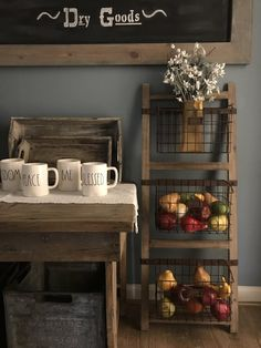 """This large basket rack can either be mounted to the wall or utilized as a floor leaner storage unit. The farmhouse chic piece of decor can be used in the kitchen to stow fruits and vegetables, in your home office to get organized, or just about anywhere in the house for decorative storage purposes. It is made of reclaimed wood and metal. The unit measures 43.5""""T x 16.5""""W x 6.5""""D."""