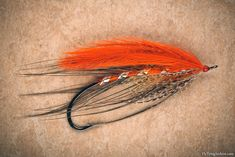 Fly Tying Archive • Orange Heron. One of the most famous Syd Glasso patterns that he used especially for winter Steelhead in the Pacific Northwest.