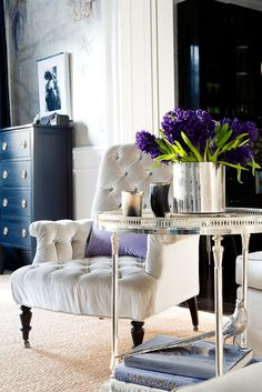 side table, tuffted chair, living room, sitting area, floral flower vase, metallic, silver, chrome, transitional, blue, purple