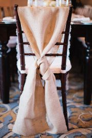 Nice way to dress up chairs - burlap tie. Earthy, rustic, elegant