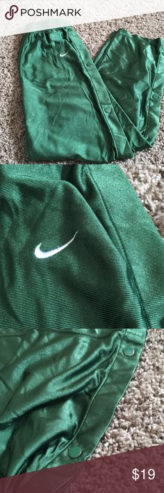 Nike button side athletic pants Size 14-16, shiny appearance green button up pants. White logo on front. EUC Nike Bottoms Sweatpants & Joggers