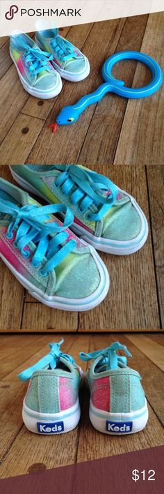 Keds Sugar Dip Double Up lace up glittery sneakers GUC. Turquoise, pink, and yellow glitter sugar dip double up Keds sneakers. Glittery turquoise laces.  These have been worn outside, but remain in good condition. Some slight condition flaws include: a bit of glitter has rubbed off on the tips of the toes, the fabric parts have some dirt from playing outside, and there is a small superficial crack on the side of one sole.  Please look at photos!  Priced accordingly! Keds Shoes Sneakers