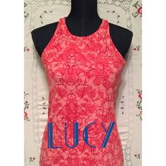 """Lucy Yoga Top LUCY stretchy yoga top with shelf bra in a beautiful coral print top. Length is 24.75 """". Looks new! Lucy Tops"""