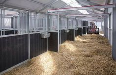 A great idea, stall partitions that slide into the aisle-way to allow easier cleaning. This would be good for any barn, but especially broodmare barns.