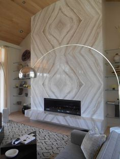 """nicest-interiors: """"This magnificent linear fireplace is surrounded by meticulously book-matched marble. Granite Fireplace, Marble Fireplace Surround, Linear Fireplace, Marble Fireplaces, Modern Fireplace, Fireplace Mantle, Fireplace Surrounds, Fireplace Design, Fireplace Ideas"""