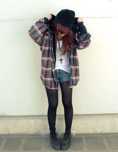 soft grunge, plaid flannel, long sleeve, button down, black tights, denim shorts, cross necklace, black ankle boots, street clothes, white tank, comfortable edgy